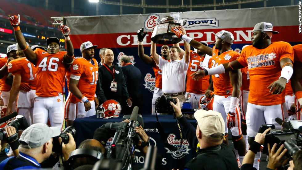 Head coach Dabo Swinney and his Clemson Tigers celebrate their 25-24 win over the LSU Tigers during the Chick-fil-A Bowl on December 31.