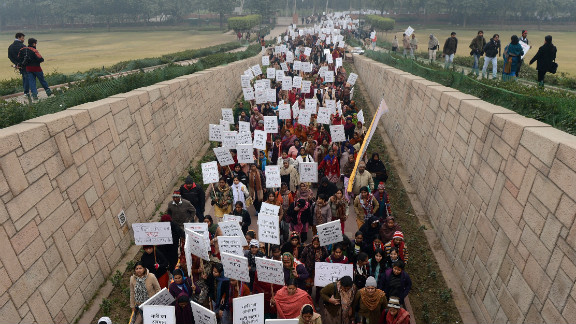 Indian women take part in the Women's Dignity March in New Delhi on Wednesday, January 2. Several hundred people participated in the solidarity march organized by the government, which ended at Rajghat, the memorial for Mohandas Gandhi.