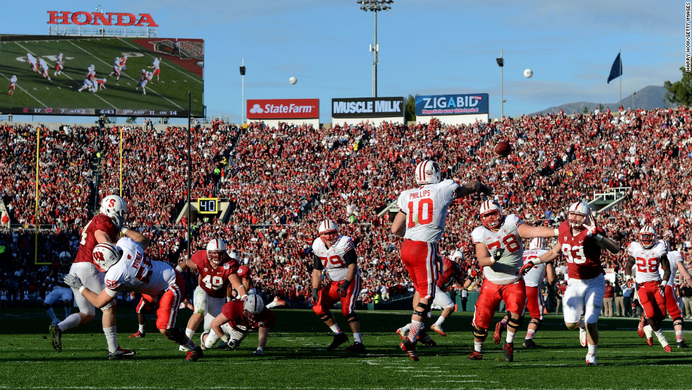 Quarterback Curt Phillips of the Wisconsin Badgers makes a pass in the second quarter against the Stanford Cardinal in the 99th Rose Bowl Game Presented by Vizio on January 1 at the Rose Bowl in Pasadena, California.