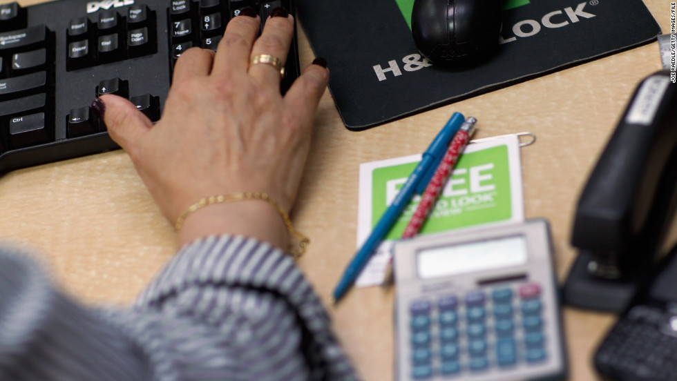 MIAMI, FL - APRIL 17: Moraiba Mata a tax professional at H&R Block inputs clients tax information on April 17, 2012 in Miami, Florida. Today is the last day to file taxes without a penalty; normally the deadline is April 15, which was a Sunday. Yesterday being Emancipation Day in the District of Columbia meant that today, Tuesday, April 17, is the due date. (Photo by Joe Raedle/Getty Images)