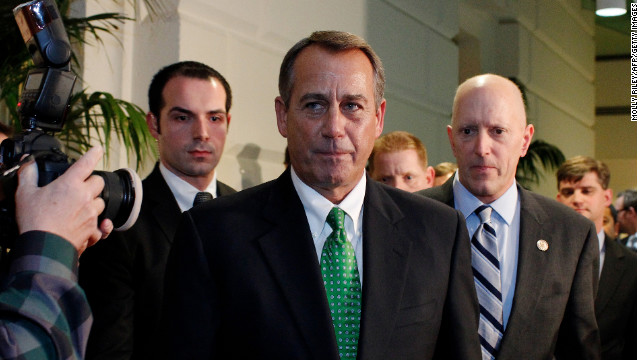 House Speaker John Boehner walks out after a second meeting with House Republicans January 1 over the fiscal cliff deal.