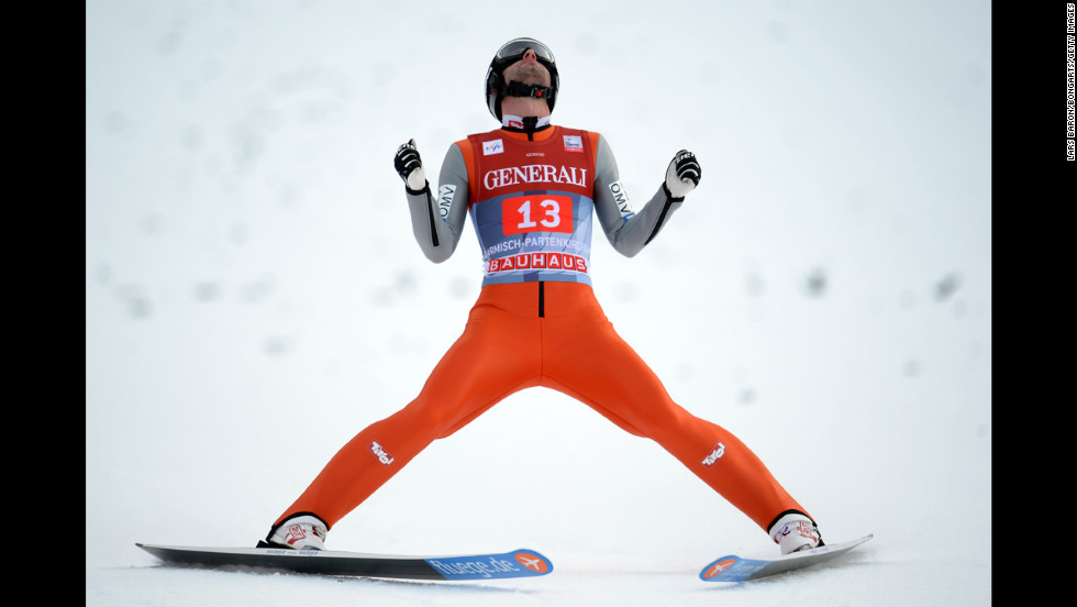 Wolfgang Loitzl of Austria celebrates after his final-round, first-leg jump on January 1.