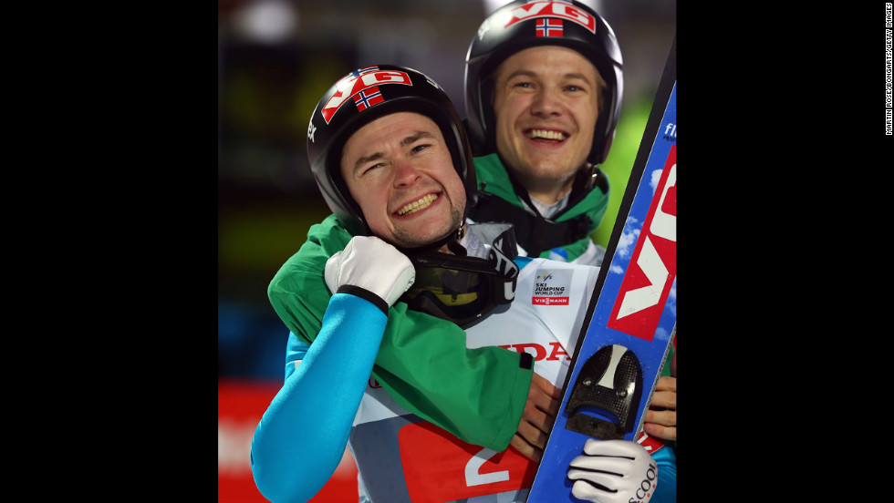 Anders Jacobsen of Norway, left, celebrates with teammate Tom Hilde after winning the final-round second leg at Erdinger Arena on Sunday, December 30, in Oberstdorf, Germany.