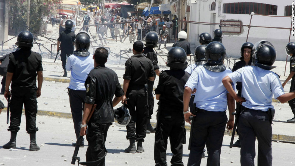 Tunisian police square off with protesters, including ultra-conservative Salafists, in Intilaka, west of Tunis in June 2012 during a wave of unrest triggered by the art exhibition.