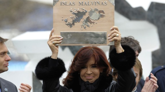 (File) Argentine President Cristina Fernandez de Kirchner holds a plaque before delivering a speech during a ceremony to mark the 30th Anniversary of the 1982 South Atlantic war between Argentina and the Britain over the Falkland Islands (Malvinas), in Ushuaia, Tierra del Fuego, some 3100 km south of Buenos Aires, Argentina on April 2, 2012.
