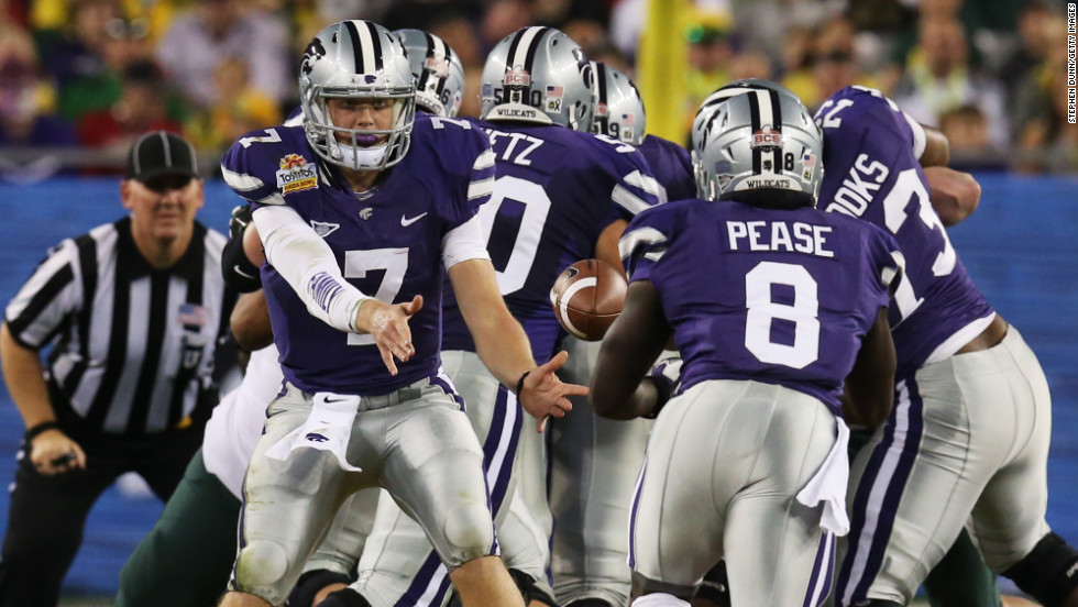 Quarterback Collin Klein pitches the ball to Angelo Pease of the Kansas State Wildcats during a play against the Oregon Ducks on January 3.