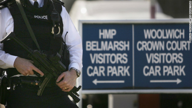 A file image of an armed police officer standing outside Belmarsh prison and Law Courts, August 8, 2005.