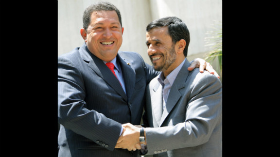 "Chavez embraces Iranian President Mahmoud Ahmadinejad, right, in Tehran, Iran, on July 1, 2007.  The two presidents have enjoyed a close relationship and Chavez has referred to Ahmadinejad as his ""ideological brother."""
