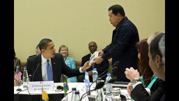 "Chavez, right, gives a copy of the book, ""The Open Veins of Latin America"" by Eduardo Galeano to President Barack Obama during a multilateral meeting at the Summit of the Americas in Port of Spain, Trinidad, on April 18, 2009."