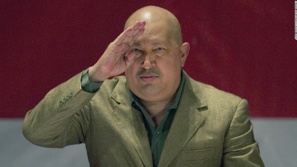 Chavez salutes to the audience after passing a law in Caracas on November 12, 2011. Chavez has undergone several rounds of cancer treatment in Cuba, beginning in 2011.