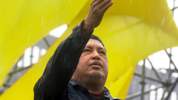Chavez gestures to the crowd during his closing campaign rally in Caracas on October 4, 2012. The leftist leader won a fourth term on October 7, extending his presidency to 2019.