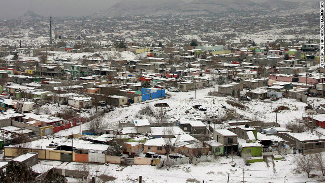 Snow blankets Ciudad Juarez, Mexico, on January 3, 2013. The same winter weather system forced the closure of Interstate 10 in El Paso, Texas, just across the border from Juarez.