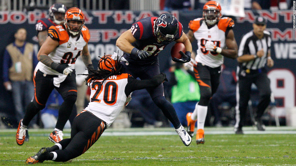 Houston's Owen Daniels attempts to pick up yardage after the catch against Cincinnati's Reggie Nelson on Saturday.