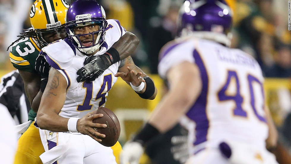 Minnesota's Joe Webb looks to pass the ball to tight end Rhett Ellison as Green Bay's Erik Walden attempts to sack Webb.