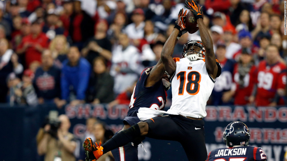 A.J. Green of the Cincinnati Bengals misses a catch against Johnathan Joseph, left, and Kareem Jackson, right, of the Houston Texans on Saturday.