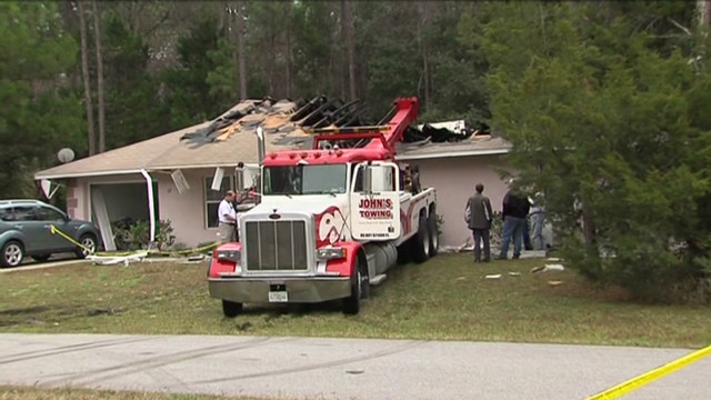 Woman survives after plane hits home