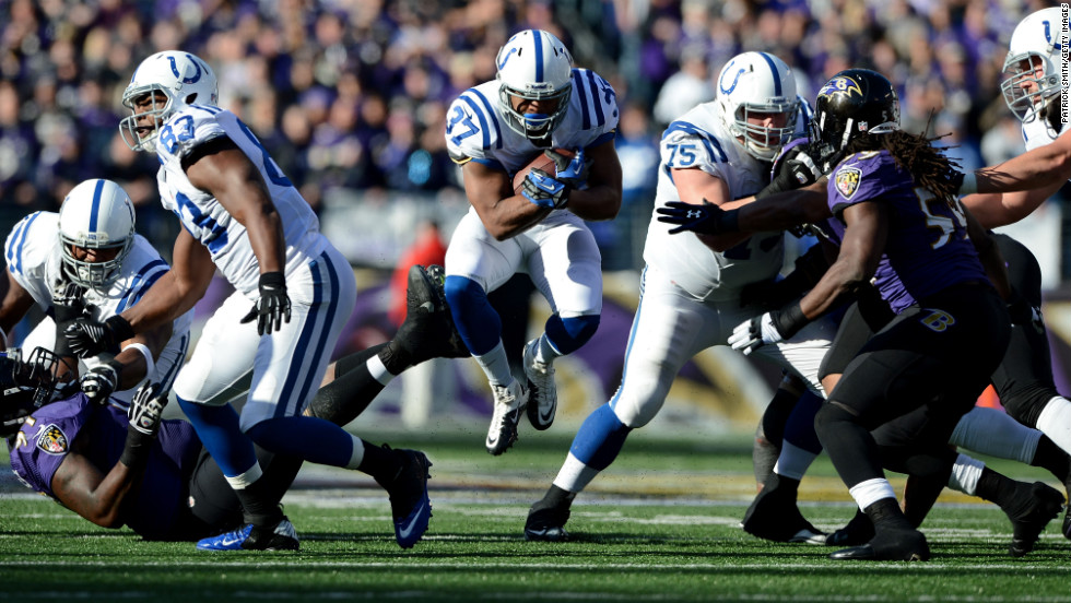 Mewelde Moore of the Indianapolis Colts runs the ball in the first half against the Baltimore Ravens during the AFC Wild Card Playoff Game at M&T Bank Stadium on Sunday, January 6, in Baltimore.