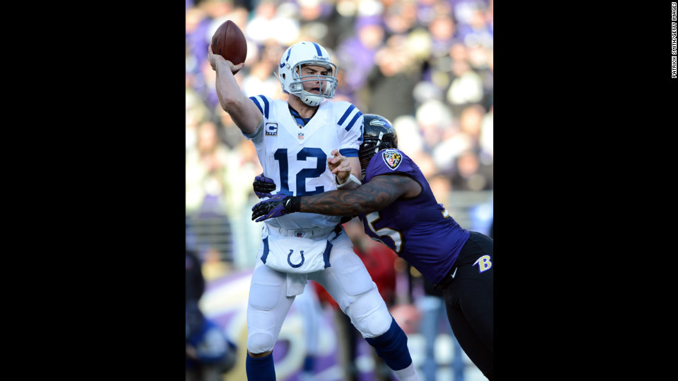 Andrew Luck of the Indianapolis Colts attempts to pass against Terrell Suggs of the Baltimore Ravens on Sunday.
