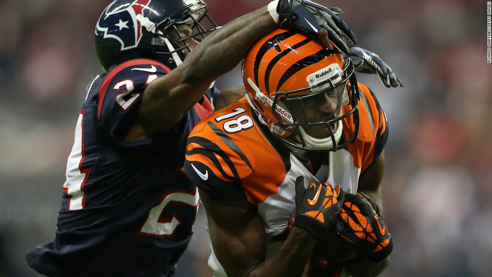A.J. Green of the Bengals catches the ball as Houston's Johnathan Joseph goes for the tackle.