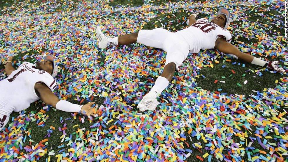 Ben Malena, left, and Trey Williams of the Texas A&M Aggies celebrate a 41-13 win against the Oklahoma Sooners during the Cotton Bowl on Friday, January 4, in Arlington, Texas.