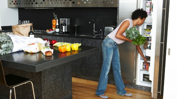 "1. Give your fridge a makeover. Let's start in the kitchen. The first thing to do is toss or give away any ""trigger foods,"" Rost says. (Yes, that means the raw cookie dough you find yourself eating at 2 a.m.) Next, move fruits, vegetables and lean protein to a shelf at eye level. Put less healthy foods farther down or in the back where they're difficult to spot. Finished? Tackle your pantry with the same tips in mind."
