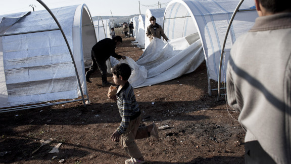 A Syrian family erects their tent at the Bab al-Salam refugee camp January 1.