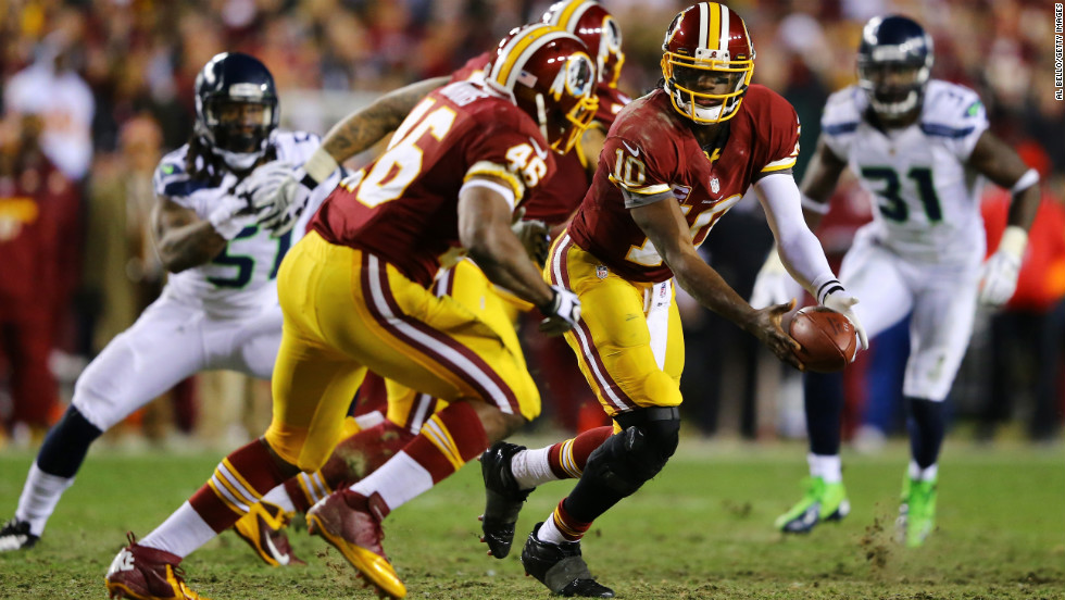 Robert Griffin III laterals to Alfred Morris of the Washington Redskins in the third quarter on Sunday.