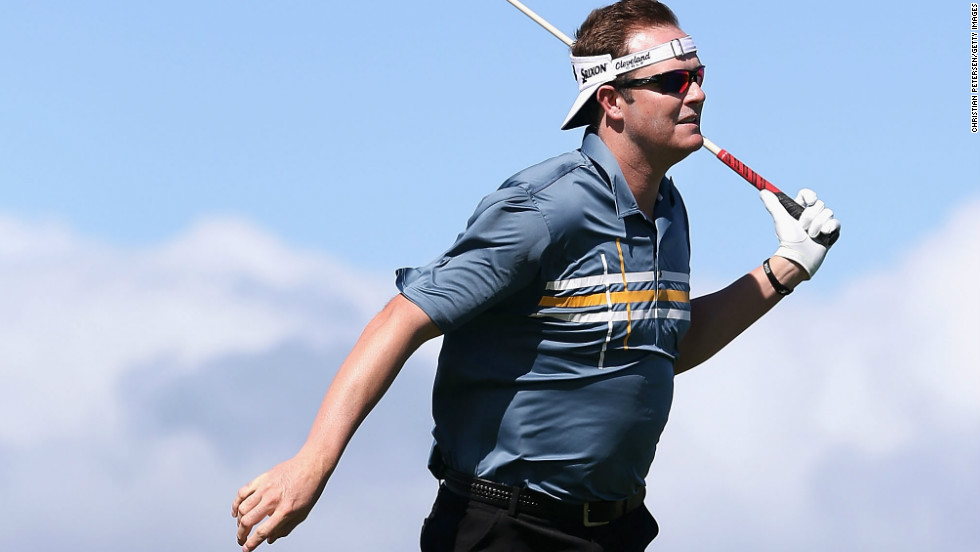 Charlie Beljan leans into the wind after taking a rehit on a tee shot on Sunday, when play was called off for the third day in a row in the PGA Tour's season-opening event.