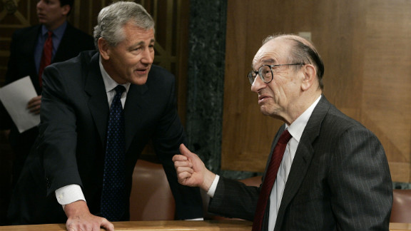 Hagel chats with Alan Greenspan, then-Federal Reserve chairman, before the start of a Senate Banking, Housing and Urban Affairs Committee hearing in April 2005.