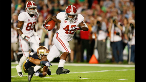 Alabama running back Eddie Lacy runs for the first touchdown of the title game against Notre Dame.