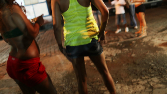 (File photo) Prostitutes walk the night streets on December 11, 2009 in Rio de Janeiro.