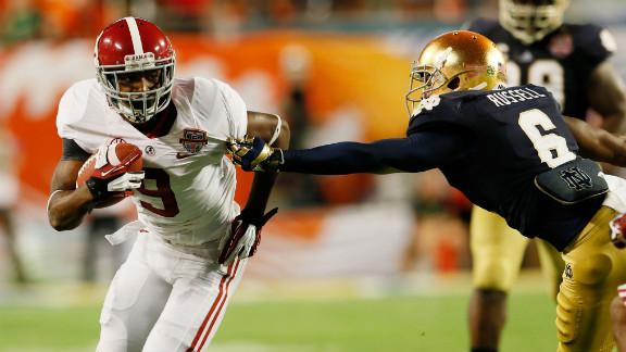 Alabama's Amari Cooper runs the ball against KeiVarae Russell of Notre Dame.