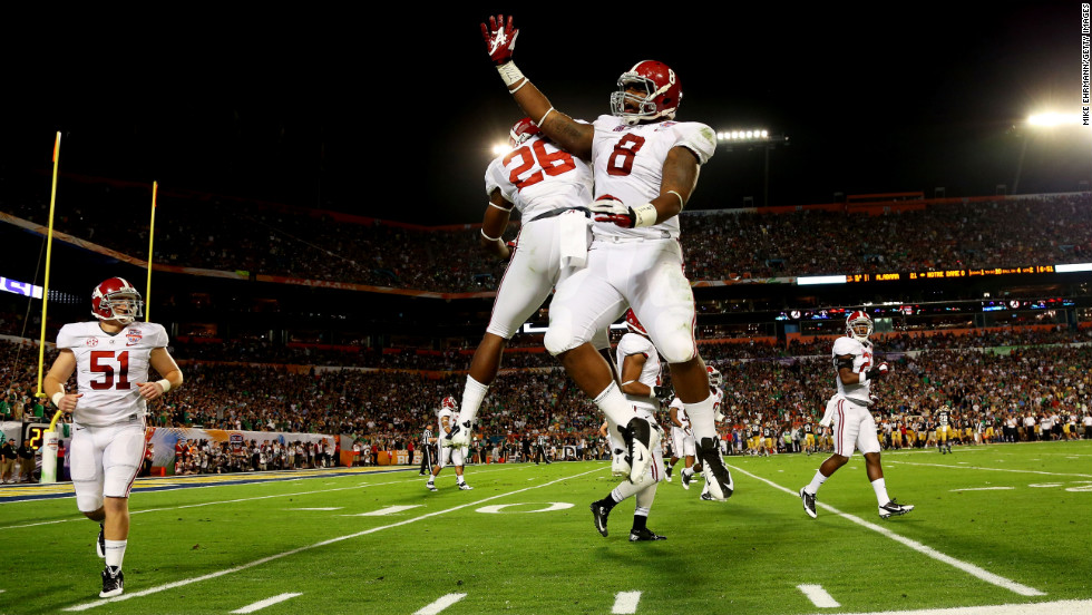 Landon Collins of the Alabama Crimson Tide, left, and Jeoffrey Pagan celebrate after pinning the Notre Dame Fighting Irish deep in their own territory.