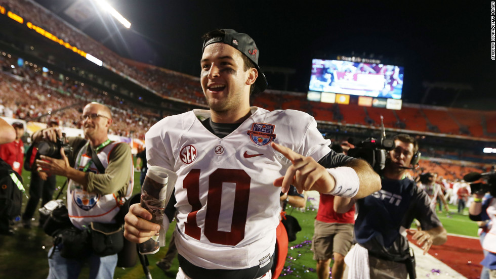 "Quarterback AJ McCarron of the Alabama Crimson Tide celebrates his team's win over the Notre Dame Fighting Irish on Monday, January 7. Alabama defeated Notre Dame 42-14 in the 2013 BCS National Championship game at Sun Life Stadium in Miami Gardens, Florida. <a href=""http://www.cnn.com/2012/12/31/football/gallery/college-bowls/index.html"">View the best photos from the college football bowl games.</a>"