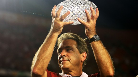 Alabama head coach Nick Saban celebrates with the trophy after defeating Notre Dame. His team won its second consecutive BCS title and third in four seasons.