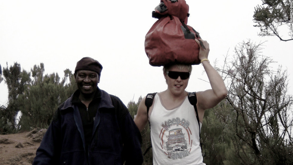 During his climb of Mount Kilimanjaro in 2008, Matthew Clough, right, discovered that his porter, Benson, left, earned only a dollar or two a day -- not enough to put a child through school. The trip inspired him to do something to help children in Tanzania get an education.