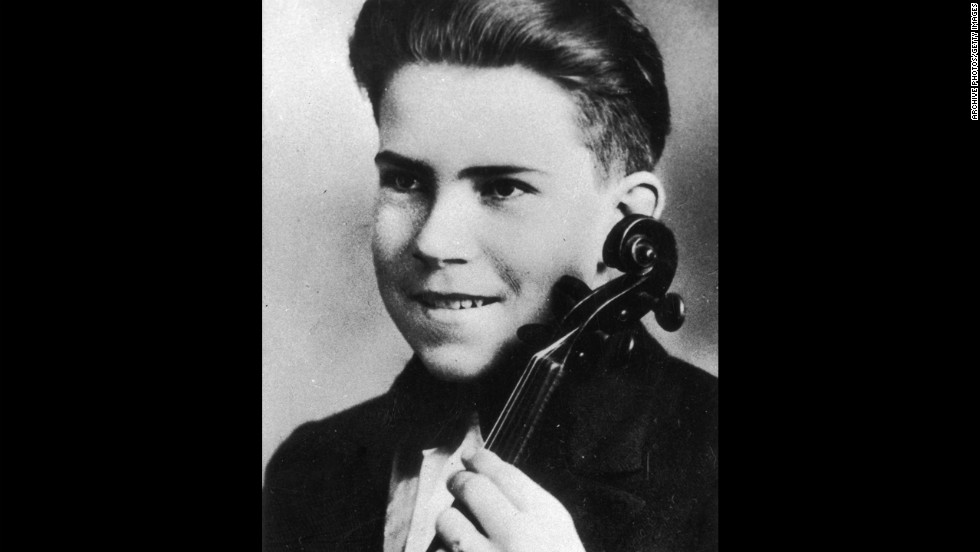 As a teenager, Nixon poses for a portrait with a violin in 1927.