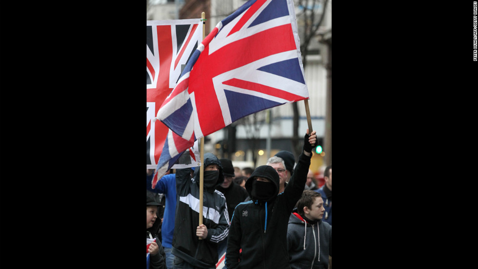 Protesters carry Union Jacks outside the City Hall on Saturday.