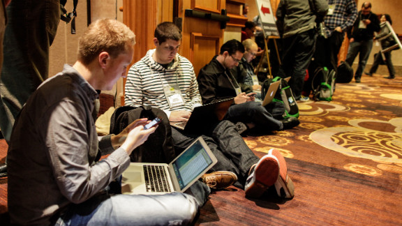 Journalists and photographers waited for hours to get into CES press conferences on Monday.