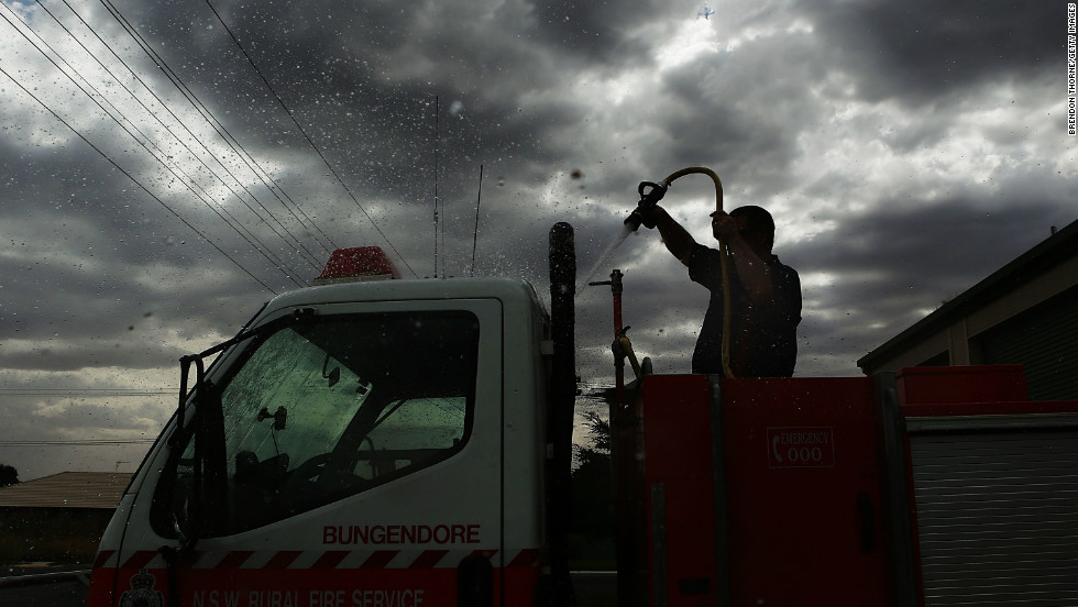 A volunteer Rural Fire Service member from Bungendore RFS washes down a emergency service vehicle on January 8, 2013 in Bungendore, Australia.