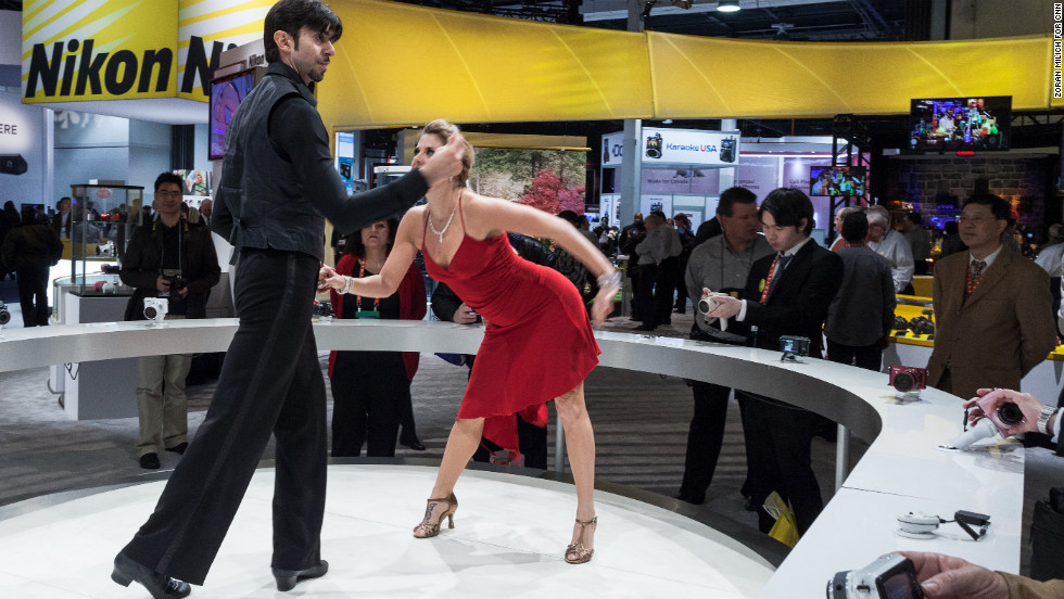 People who wanted to demo Nikon's new cameras Tuesday could snap photos of these dancers at the Nikon booth.