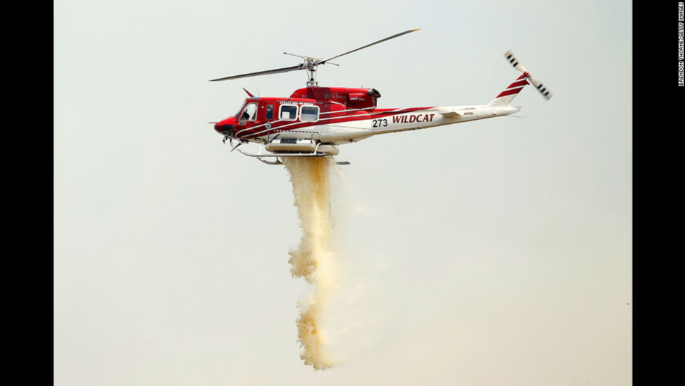 A chopper carries out water-bombing operations on a fire at Sandhills in Bungendore on January 9.