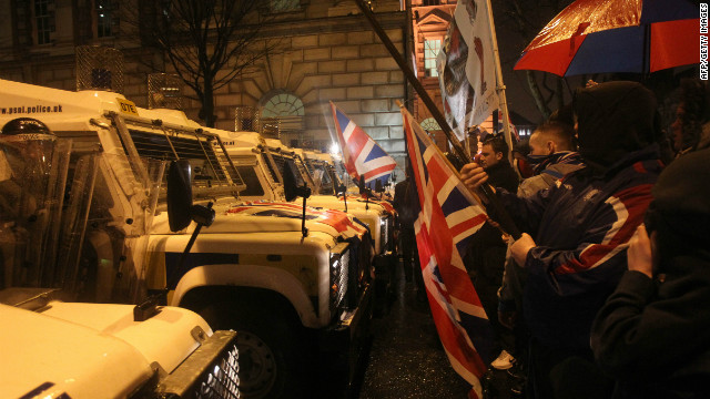 Loyalist protesters confront police at Belfast City Hall in Northern Ireland on January 7, 2013.