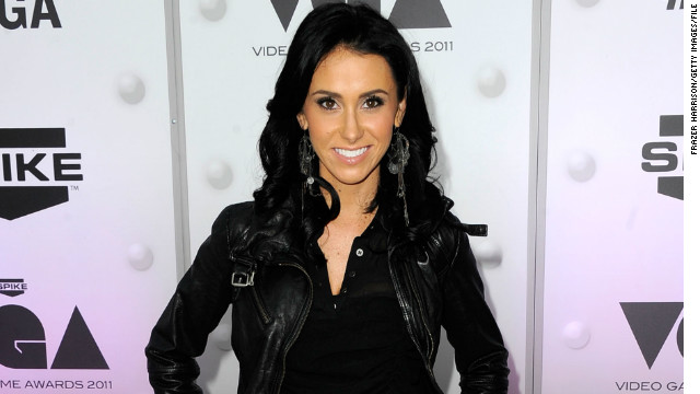 Jenn Sterger, shown here at Spike TV's '2011 Video Game Awards' in Los Angeles, stepped into the limelight when Musburger alluded to her beauty when ABC showed her at a 2005 football game.