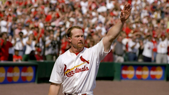 Mark McGwire of the St. Louis Cardinals waves to fans after hitting his 70th home run of the 1998 season during a game against the Montreal Expos. He broke the single-season home-run record in a race against rival Sammy Sosa.