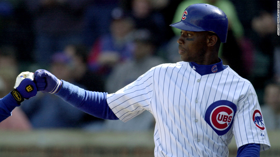 Fred McGriff of the Chicago Cubs celebrates during a game against the New York Mets at Wrigley Field in Chicago on April 10, 2002.