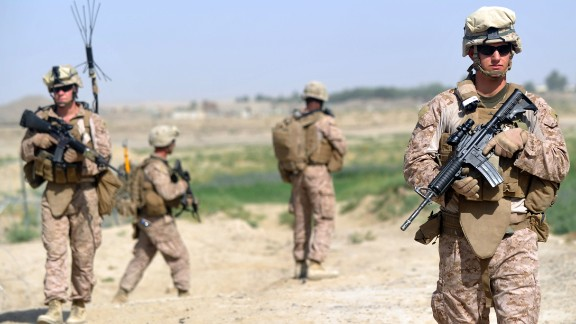 US Marines from Kilo Company of the 3rd Battalion 8th Marines Regiment start their patrol from FOB (Forward Operating Base) Delhi in Garmser, Helmand Province on June 27, 2012. The 130,000 NATO troops are due to leave Afghanistan by the end of 2014 and there are fears that their exit will lead to a reduction in rights and freedoms in the war-torn country. AFP PHOTO / ADEK BERRY        (Photo credit should read ADEK BERRY/AFP/GettyImages)