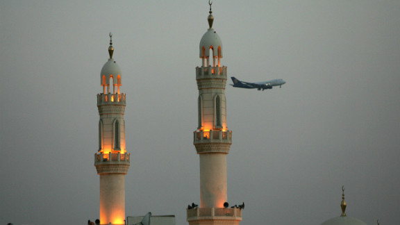 Modern and traditional: A plane flies over minarets in Dubai.