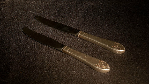 A pair of silver knives believed to have been pilfered by the same guest at two separate Waldorf events in the 1950