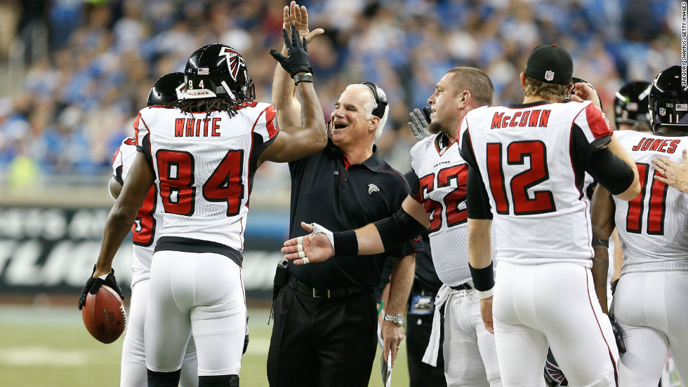 Falcons head coach Mike Smith high-fives Roddy White after his second quarter touchdown while playing the Detroit Lions last month.